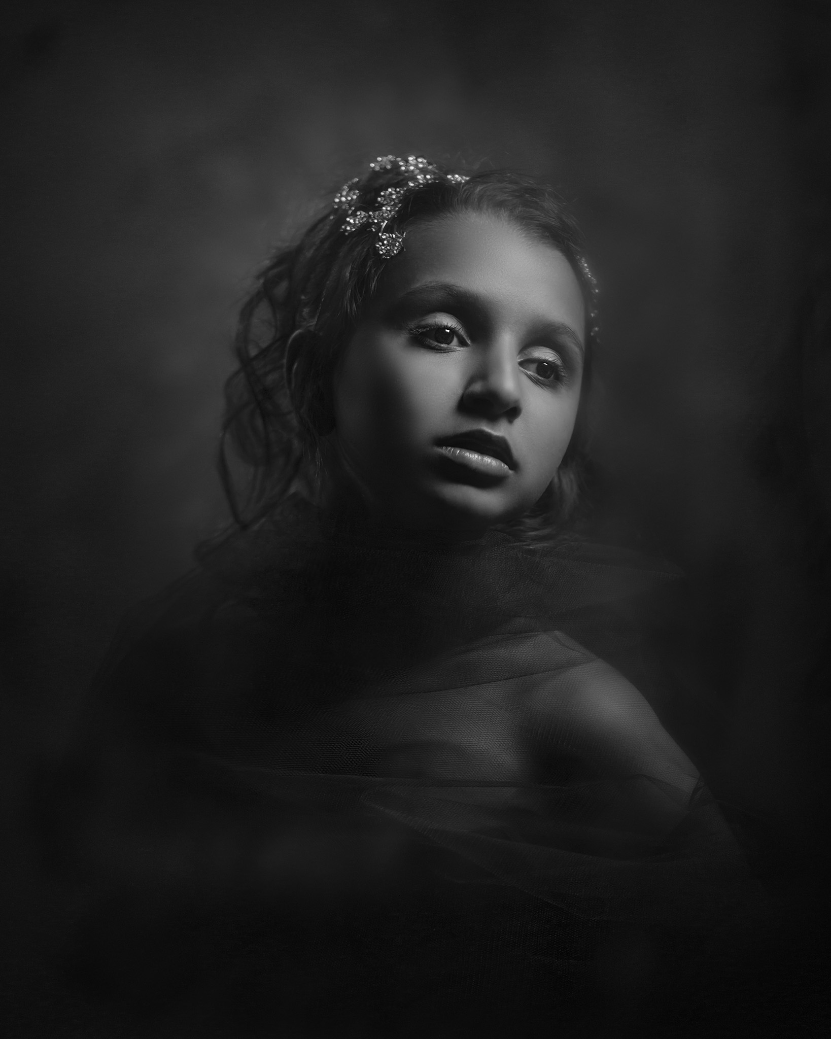 Tintype inspired black and white photo of a child by Melbourne portrait photographer Rocco Ancora